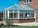 a white upvc conservatory and dwarf wall